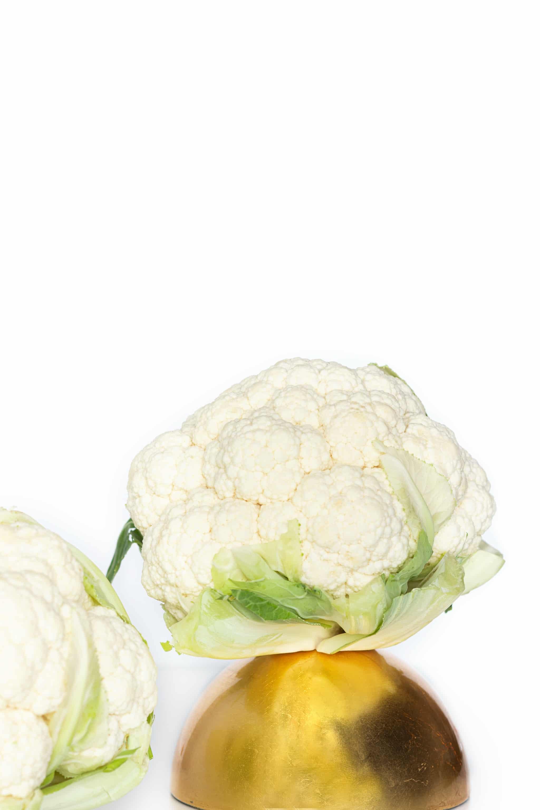 cauliflower sitting on gold bowl