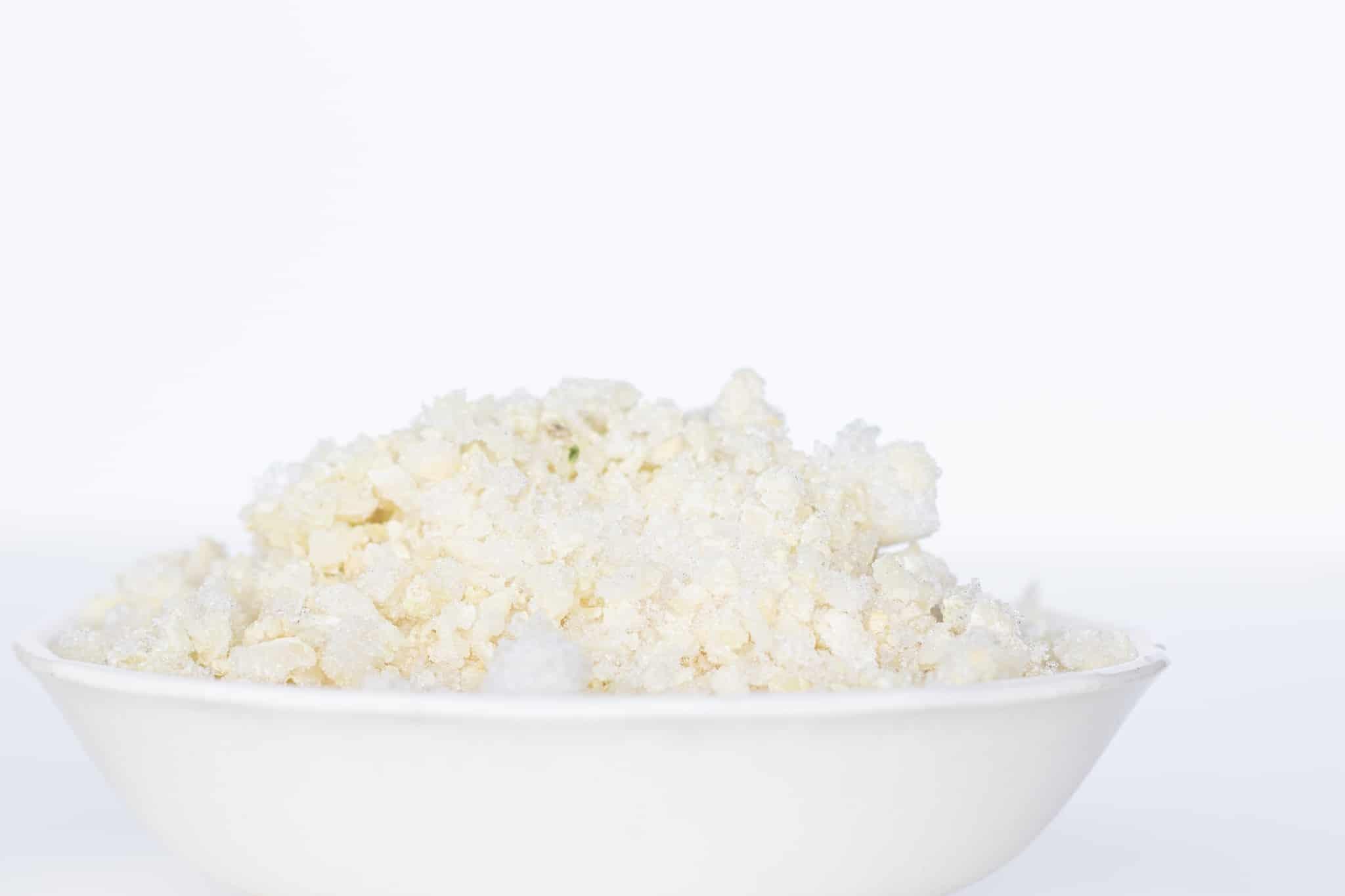 frozen cauliflower rice in white bowl