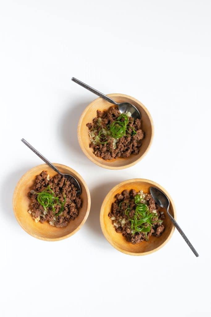 overheard of three garlic ground beef and cauliflower 'caulirice' bowls with spoons