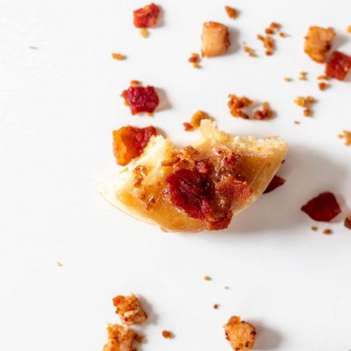 last bite of a keto maple bacon donut